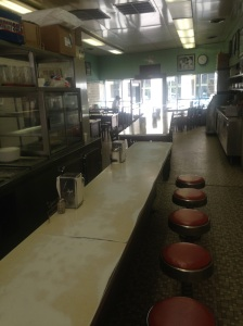 The interior, with countertops worn from many elbows leaning on them and bellying up to an authentic Coney dog.