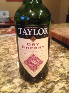 Dry Sherry--it is excellent in seafood dishes and really makes the sauce in for many Asian dishes. Buy a bottle, it lasts for a while and every cook needs it in their kitchen.