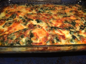My contribution to the meal (picture taken before it got jostled on the walk to their house): a sweet potato and spinach gratin with thyme and gruyere cheese
