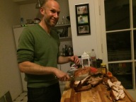 """While Sam was carving the turkey, I snuck into the kitchen for an """"action shot."""" The turkey was perfect--crisp skin and juicy, succulent meat."""