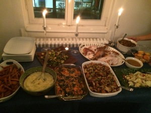 The spread. From left to right: roasted baby carrots with chipotle glaze; mashed potatoes with truffle oil; my sweet potato gratin; Ann's New England Stuffing with sausage, cranberries and apples; roasted cauliflower with mint, pomegranate and yogurt; gravy; cornbread; leek and mushroom stuffing; the turkey; roasted brussels sprouts with Asian vinaigrette