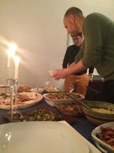 Sam and Thomas dishing up their food.