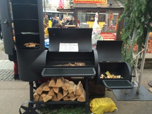 "A bit of home-- we passed a booth that advertised ""pulled pork from the smoker!"" The smoker was sitting next to it, clearly unused, to let people know what a smoker was.  It was surrounded my a semi-circle of German men with appreciative looks on their faces"