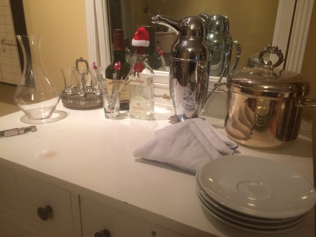 An incomplete drink station, awaiting some wine and water. Notice that I already laid out the wine opener and decanter